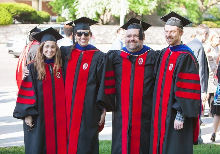 recent grads pose with their advisors